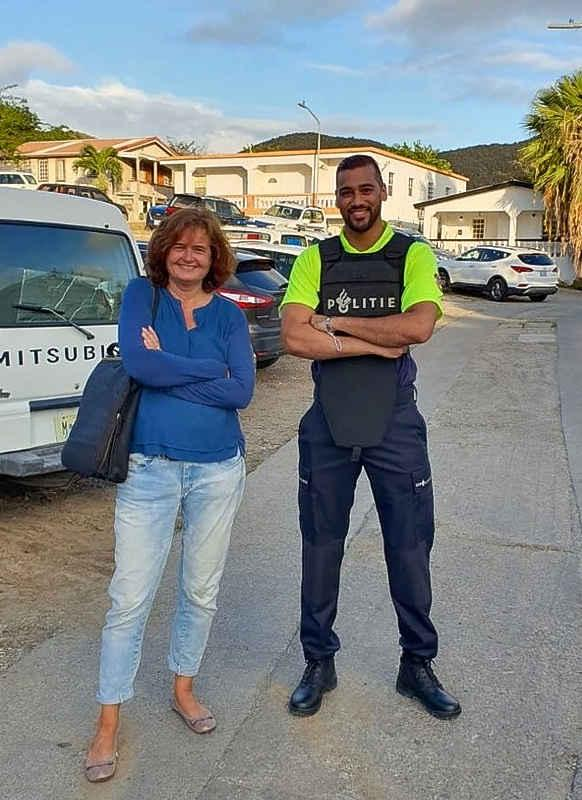"""Vidjin Awadhpersad (right) is working with KPSM for the next three months to learn about the internal procedures of the police as well as practical experience as an """"officer on the beat"""". He is seen in police uniform together with St. Maarten's Chief Prosecutor Mirjam Mol."""